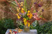 Our fall arrangement includes:Asters, Hydrangeas, Miscanthus, Molinias, Persicarias, Salvias,  and VerbenasI wanted this arrangement to celebrate the diverse beauty that autumn affords. It was photographed by acclaimed garden photographer, Saxon Holt, who happened to be visiting us.Autumnal Fanfare: Lambent Leaves, Glistening Berries, Fleeting Flowers, last chance for Fantastic Fall Sale, Gift Certificates now on sale!